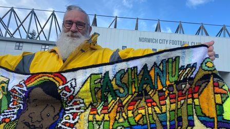 Artist David Shenton outside Carrow Road with his handcrafted banner.