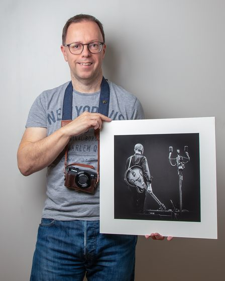 Steve Collins with his original photo of Matt Johnson from The The.