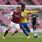Arsenal's Martin Odegaard and Brighton and Hove Albion's Yves Bissouma battle for the ball during th