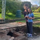 Jo and daughter ChloeGriffiths stood outside therare find in their back garden.