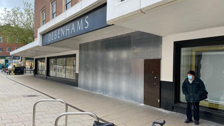 Boarded up entrances to the former Debenhams store in Norwich.