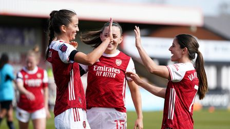 Arsenal's Anna Patten (left) celebrates scoring their side's seventh goal of the game during the Vit