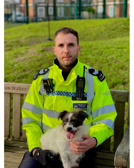 Sgt John Hounsell with a lost dog in Kentish Town