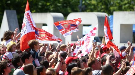 Arsenal fans show their support near the Emirates Stadium. (Photo by Charlie Crowhurst/Getty Images)