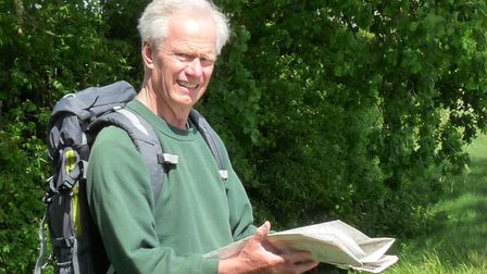 Peter Cooper holds a map