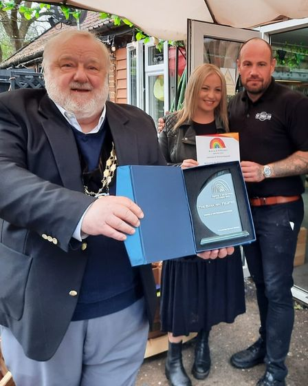 Martin Foley of Uttlesford District Council with Peter White and Lauren Murray of The Swan Inn, Felsted