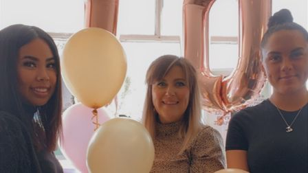 Celebrating, from left, apprentice Yano Suttharit, salon owner Katie Mia Fowler and stylist Chloe Shirlow