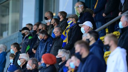 Torquay United fans return during the National League match between Torquay United and Barnet at Pla