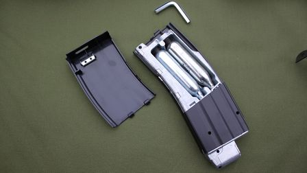 The removable magazine holds two 12g CO2 bulbs