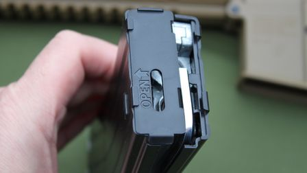 The side of the magazine comes off to gain access inside