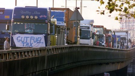 Fuel protesters' lorries line a fly-over on the A40 after they attended the fuel tax protest in Hyde