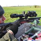 Another Eley Contact ejects from the action reliably and notice zero muzzle flip and small exhaust g