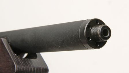 The aluminium barrel sleeve gives a varmint profile and is tensioned by the threaded end cap