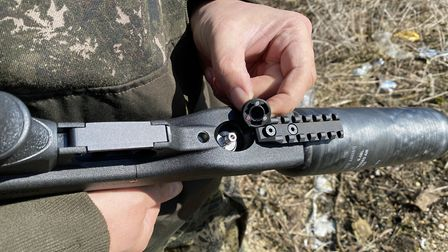 There's a Picatinny rail for a bipod in front of the magnetic fill port