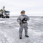 A soldier holds a machine gun as he patrols the Russian northern military base on Kotelny island, beyond the Artic circle