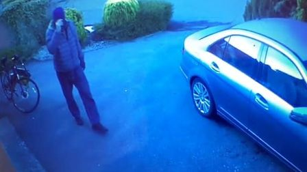 CCTV footage has emerged of a suspicious looking man allegedly attempting to break into properties in Thorpe St Andrew