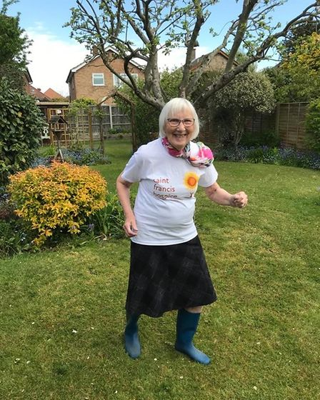 A lady showing support for Saint Francis Hospice from her back garden.