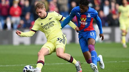 Arsenal's Emile Smith Rowe (left) and Crystal Palace's Wilfried Zaha battle for the ball during the