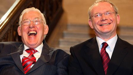 Ian Paisley (L) and Martin McGuinness after being sworn in as ministers of the Northern Ireland Assembley
