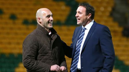 Malky Mackay, pictured at Carrow Road with Craig Fleming, is back in management at Ross County