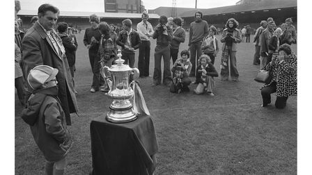 Ipswich Town fanstake pictures of the FA Cup at the club open day in 1978