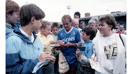 Ipswich Town legend Mick Mills signing autographs for fans at a football fun day in 1988