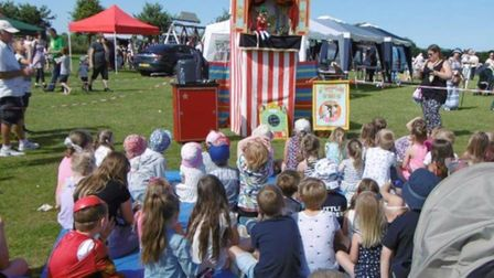 Children enjoy a Punch and Judy show at a previous Belton Fun Day.