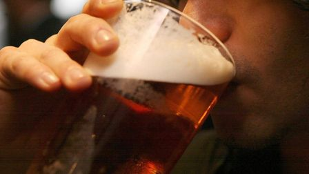 EMBARGOED TO 0001 MONDAY JANUARY 28 File photo dated 01/12/06 of a man drinking a pint of beer. The