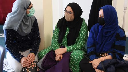 Sisters Syeda Shah, left, and Jawaria Syed, centre, and their mum, Asra Zoofishan,