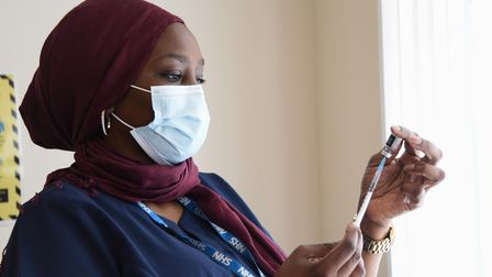 Khadijat Adegoke, clinical pharmacist, administers Covid vaccinations at Norwich Central Mosque