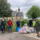 Outside St Peter's Church with some of the bags collected:Margaret Gannaway; Cllr John Howard; Jen