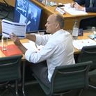 Dominic Cummings, former Chief Adviser to Prime Minister Boris Johnson, holds up a document whilst g