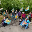 Tales of the Fanns walkers carried silk flags made with Kinetika showing the stories of the land