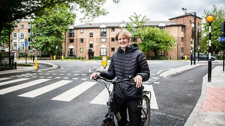 Cllr Champion on her bike by the new continental-style roundabout in Highbury