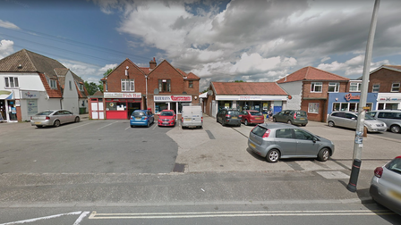 The row of shops on Wroxham Road in Sprowston where new road safety signs were installed
