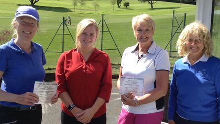 Sue Dowen 2nd prize, Georgia King from Kings Garden Centre and Vanessa Ireson 1st prize, with Lady Captain Mo Kendall