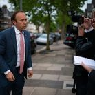 Health Minister Matt Hancock with members of the media outside his home in north west London. Domini