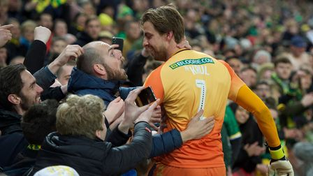 Tim Krul goalkeeper of Norwich City celebrates with fans after winning promotion to the Premiership