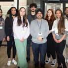 a group of students in Havering with their tutor in the middle.