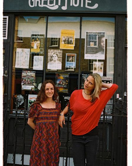 Immy and Risa outside the Green Note in Parkway Camden Town
