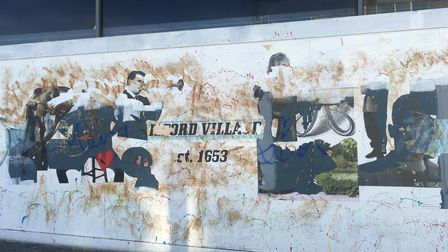 A mural celebrating the history of Ilford Village on display at the former Bodgers department store.