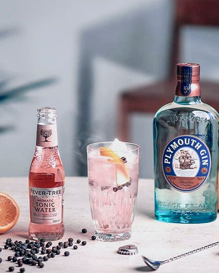 A Plymouth Gin bottle and a bottle of pink aromatic tonic.