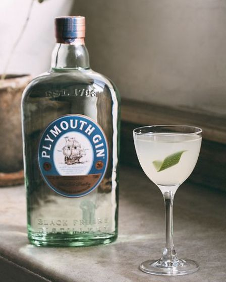 A bottle of Plymouth Gin and a cocktail in a glass.
