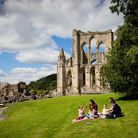 M72GR8 Picnic on a summer at Rievaulx Abbey the first Cistercian monastery in the north of England,