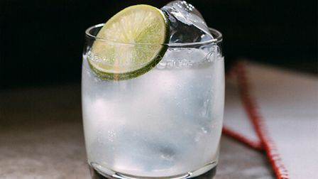 A cocktail glass with ice in.