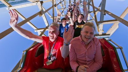 Thrill-seekers upside down on a rollercoaster.