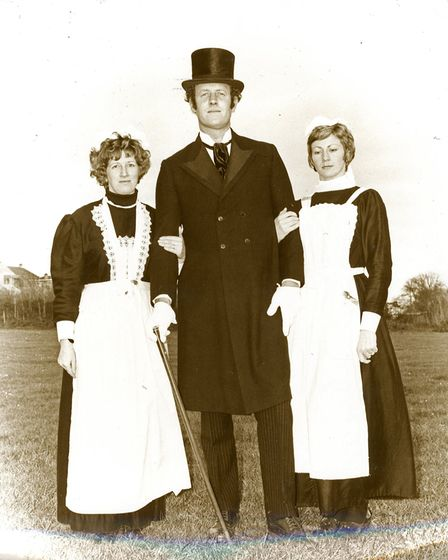 ChairmanSir John of Daccombewith two of his kitchen maids, brought along to serve the half-time wine