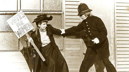 Constable Stuart Bridge comes to grips with a suffragette, outside the Clennon Valley changing rooms