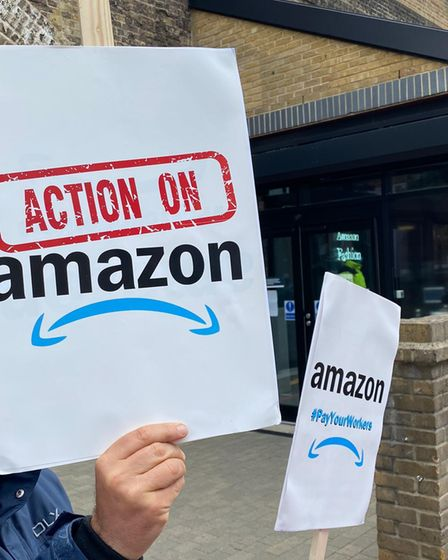 Campaigners protest Amazon's treatment of workers.