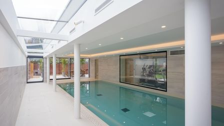 coombes everitt home built with a pool and gym in a home in Cheltenham, England.